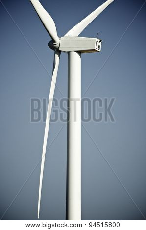 windturbine for electric energy production with blue sky
