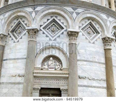 Detail of the ornate decorations of the landmark Leaning Tower located in Pisa, Italy.