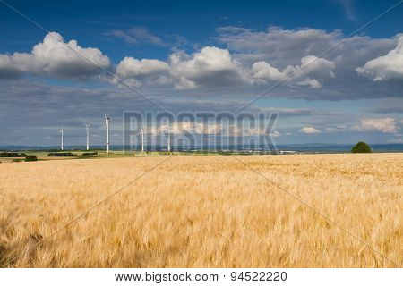 Golden wheat field and wind turbines Hohe Strasse Wetterau Germany poster
