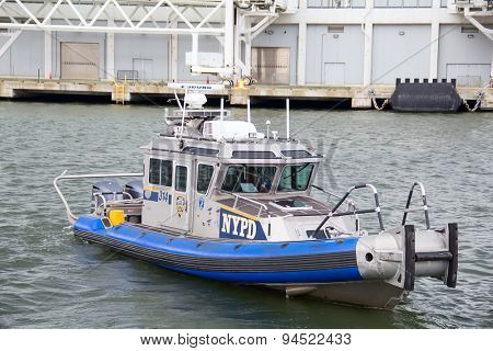 NEW YORK CITY - OCTOBER 30: NYPD Police boat leaving pier for patrol sevice in NYC on October 30, 2014.The Police Department (NYPD), established in 1845,is the largest municipal police force in the US