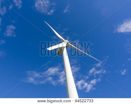 Single Wind Turbine Stopped In Blue Sky