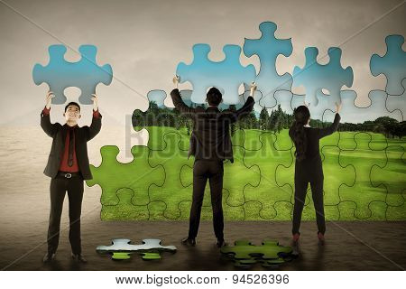 Business Teamwork Assembling Puzzle Pieces Create Green Environt