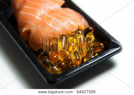 Salmon Sushi Served With Fish Oil Pills Closeup Isolated