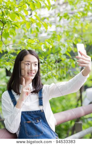 Girl With A Cell Phone Self-timer
