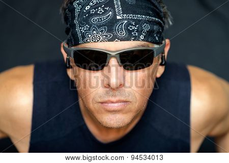 Intense Athletic Man Looks To Camera