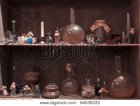 antique showcase with standing vessels