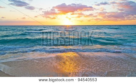 Sunrise and ocean golden wave on Miami Beach, Florida, USA .