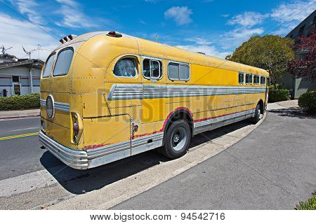 Old Schools Bus Parked On The Side Of Road