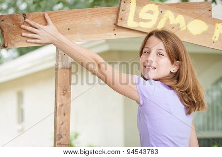 Young Girl Painting Lemonade Stand