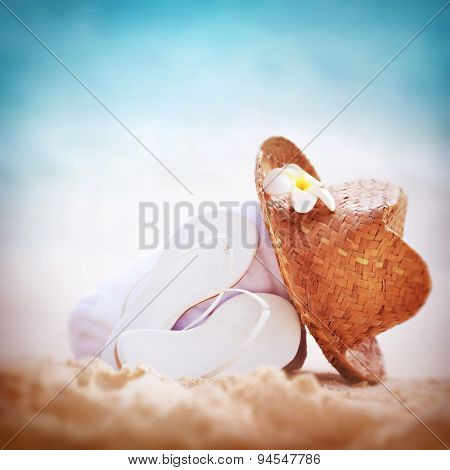 Summer holidays background, beautiful beach items on sandy coast, vacation border with copy space, traditional beachwear, relaxation concept
