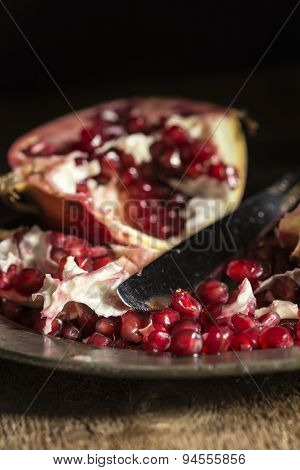 Moody Natrual Lighting Images Of Fresh Juicy Pomegranate With Vintage Retro Style