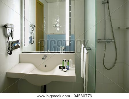 The Equipment Of The Room With A Wash Basin And A Shower