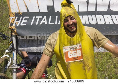 Man Dressed As A Banana During The Mud Race Competition