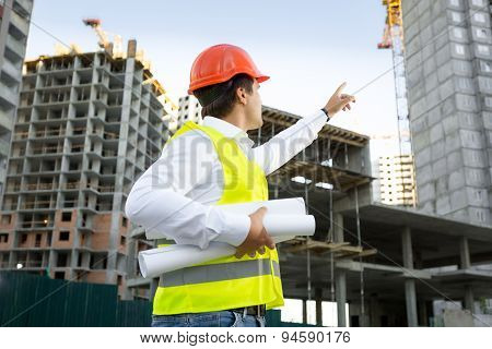 Site Manager Checking Building Site Under Construction