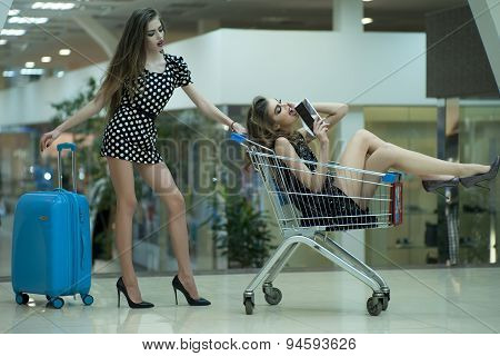 Young Women With Shopping Trolley And Bag
