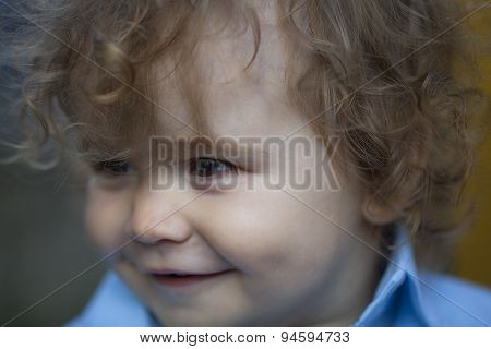 Close Up Portrait Of A Smiling Little Baby Boy