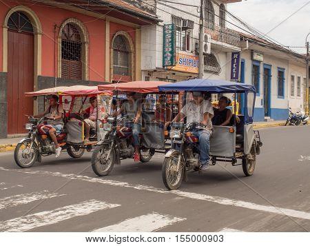 Rickshaws On A  Street