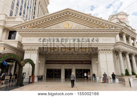 Las Vegas USA - October 28 2016: People entering Caesars Palace on the Vegas Strip in Las Vegas NV. Caesars Palace is a luxury resort famous casino and an iconic brand.
