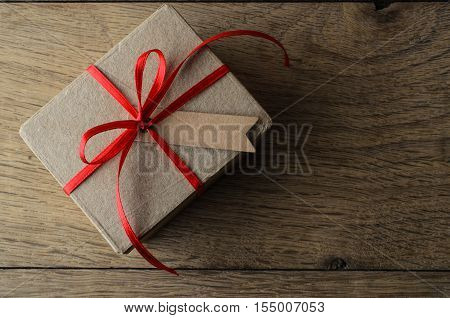Brown Gift Box With Red Ribbon And Blank Tag