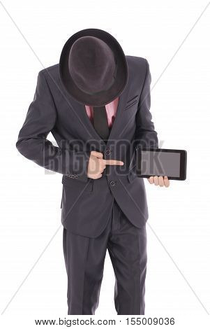Boy in a suit points to the tablet PC isolated on white