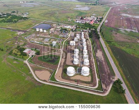 Aerial View Of Oil Storage Tanks. Industrial Facility For The Storage And Separation Of Oil