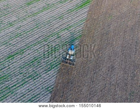 Top View Of The Tractor That Plows The Field. Disking The Soil. Soil Cultivation After Harvest
