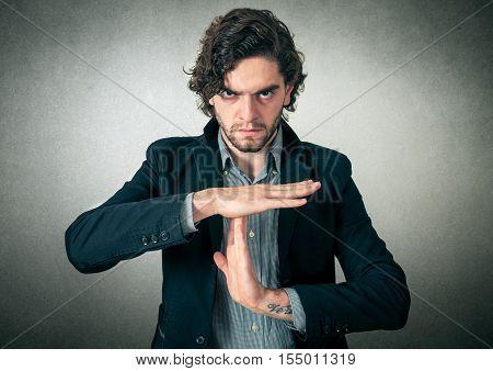 Man close up making a stop sign