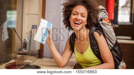 Happy And Euphoric Backpacker Female Tourist Shows Ticket For Her Trip