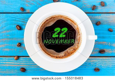 November 22nd. Day 22 of month, calendar on funny coffee cup at Programmer Analyst workplace background. Autumn time. Empty space for text.