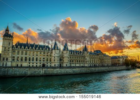 View Of The Conciergerie In Paris At Sunset