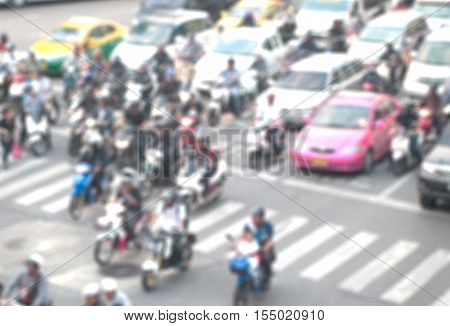Blurred background of traffic jam, cars ,motorcycle in traffic, Len flares effect.