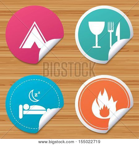 Round stickers or website banners. Food, sleep, camping tent and fire icons. Knife, fork and wineglass. Hotel or bed and breakfast. Road signs. Circle badges with bended corner. Vector