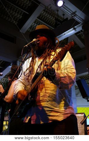 HONOLULU HI - APRIL 23: Lead singer of Guidance Band Keith Batlin singing and jams on stage at Mai Tai Bar in Ala Moana Shopping Center on April 23 2016 Honolulu Hawaii.