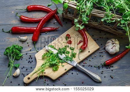 Harvesting homegrown spices for healthy meal on old wooden table