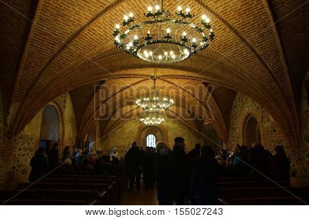 Trakai Lithuania - October 16 2016: Trakai castle on the lakes is visited by hundreds of thousands of tourists every year. Inside the castle premises.