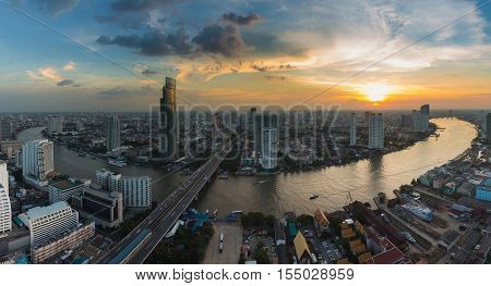 Panorama Bangkok city downtown river curved during sunset, Thailand