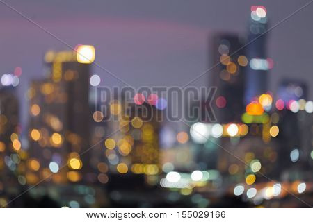 Blurred bokeh light city office building downtown night view, abstract backgrund