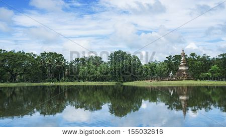the water lake with buddhist ancient monument building and nature grassland with trees in the park Ayutthaya Thailand
