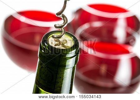 Opening Wine Bottle On Red Glass Background