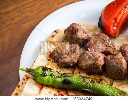 Lamb kebabs with flatbread tomato and pepper