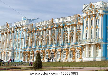 ST. PETERSBURG, RUSSIA - APRIL 17, 2016: Fragment of a facade of Catherine Palace in the cloudy April afternoon. The historical landmark of the Tsarskoye Selo
