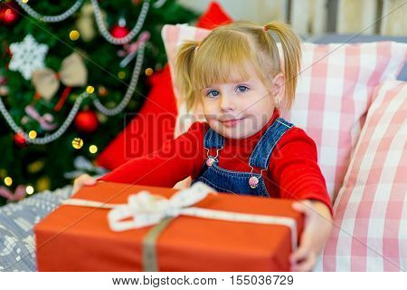 Happy Child Girl With Christmas Gifts