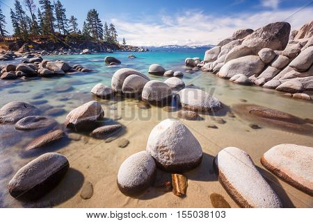 Natural rock formation against Lake Tahoe in the background