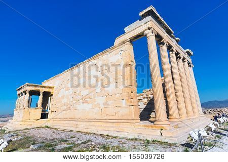 Acropolis, Erechtheum Temple in Athens, Greece and blue sky