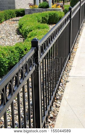 Length of beautiful black,wrought iron fencing marking property lines.