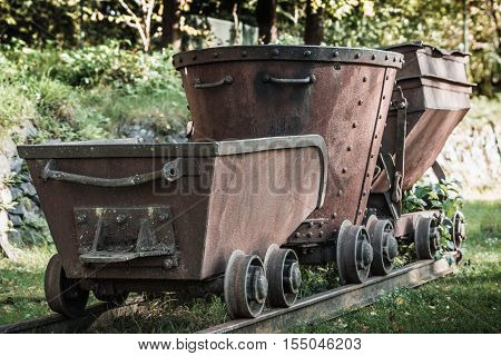 Very old mining train. rusty and worn. used to transport ore from the mine.