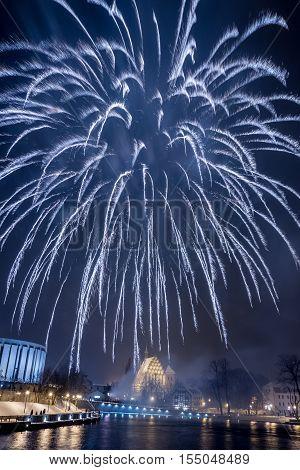 Big Spectacular Fireworks Over River At Night