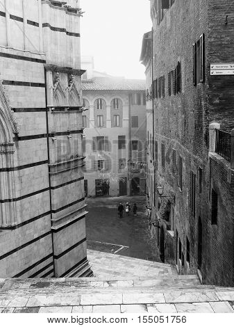 Siena Italian medieval town - Cathedral in a foggy day in black and white