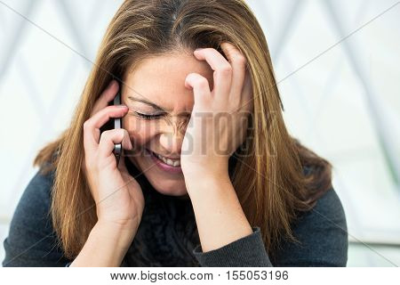 Young Woman Delighted On The Phone