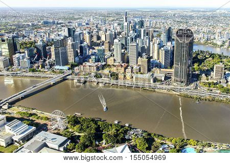 BRISBANE, AUSTRALIA - OCTOBER 18 2016: Brisbane CBD cityscape and 1 William Street with South Bank and ferris wheel in the foreground